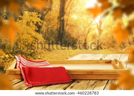 autumn background of red napkin and tray