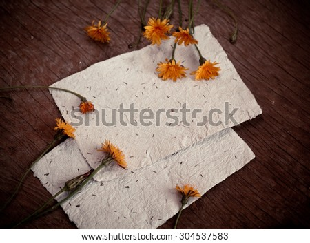 Autumn background with colorful yellow dandelion flowers on wooden background. Fall theme, Autumn concept background with yellow flowers and copy space