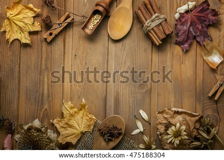 autumn background with fruits and spices with dried flowers place for inscription (top view)