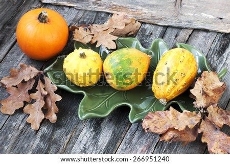 Autumn background with pumpkins on wooden board - stock photo