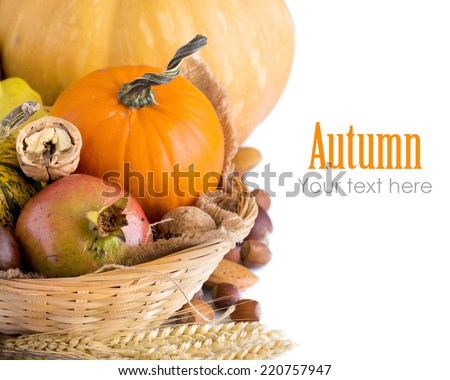 Autumn background with pumpkins, pomegranate and nuts