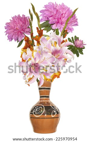 Autumn beautiful bouquet flowers in vintage ceramic vase isolated on white background - stock photo