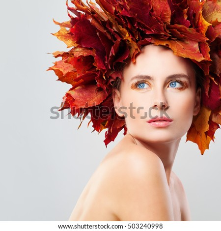 Autumn Beauty. Beautiful Woman in Wreath of Fall Leaves