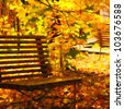 autumn bench in red and yellow autumn leaves of park drawing imitation by watercolor paints - stock photo