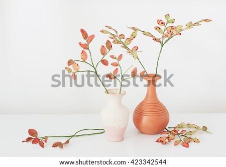 autumn blueberry branch in vases - stock photo