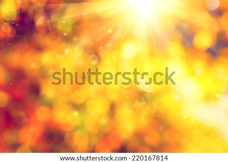 Autumn. Blurred Fall Abstract autumnal background with colorful leaves and sun - stock photo