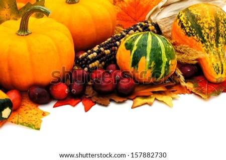 Autumn border with leaves, pumpkins, gourds and corn - stock photo