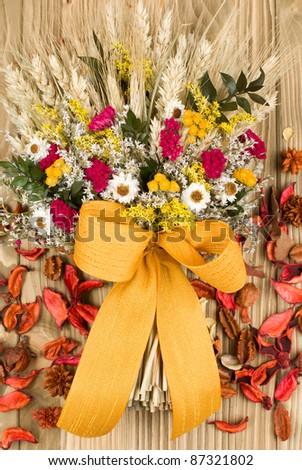 Autumn bouquet arrangement on wooden background - stock photo