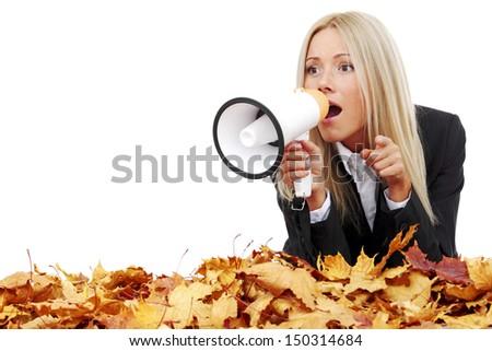 autumn businesswoman with megaphone studio isolated in studio - stock photo
