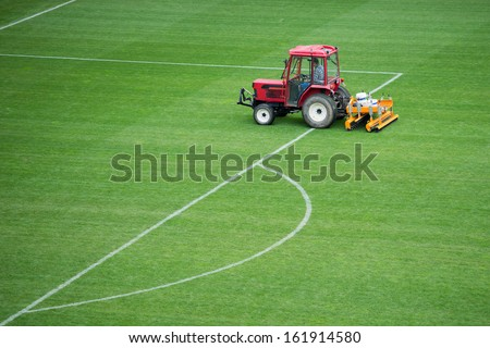 Autumn care of the football pitch - stock photo