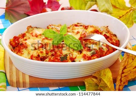 autumn casserole with minced meat , zucchini,mushrooms,potato,tomato and cheese - stock photo