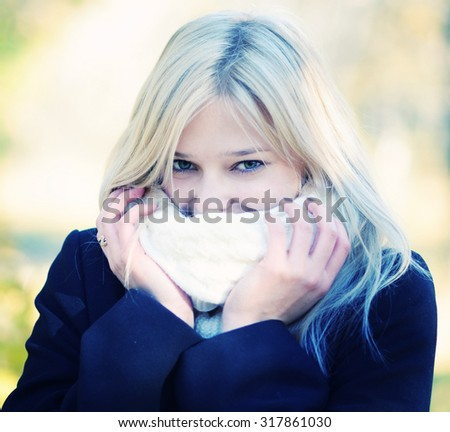 autumn cold portrait of a young beautiful woman - stock photo