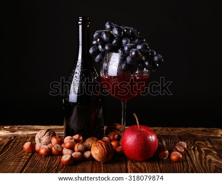 Autumn Collection. Glass of wine with boutle on  dark background - stock photo