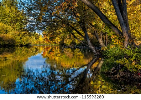 Autumn colored trees line the Boise River in Idaho - stock photo