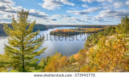 Autumn colors at Lumberman's Monument on the Highbanks Trail, on the AuSable Scenic Byway in the Huron National Forest, near Oscoda, Michigan.