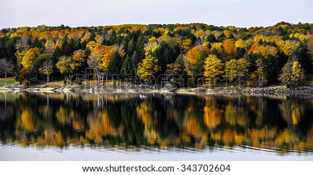 Autumn colors create a radiant reflection in Batchellerville, New York.
