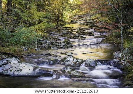 Autumn colors reflected in the Little River as it meanders through Great Smoky Mountains National Park, Tennessee.   - stock photo