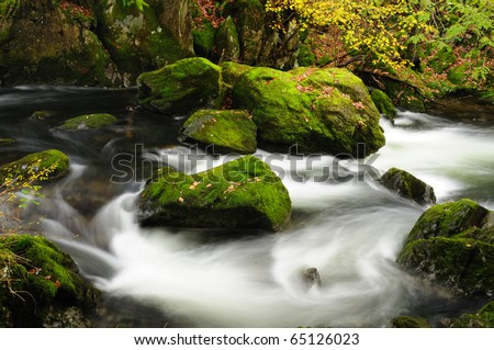 Autumn colours and river in the English Lake District - stock photo