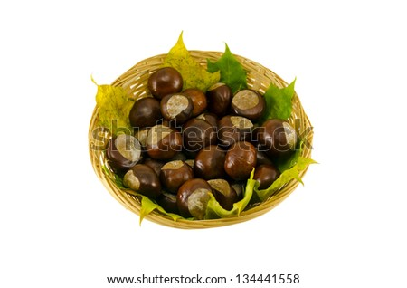 autumn composition chestnut wicker basket with autumn leaves isolated on white background - stock photo