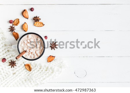 Autumn composition. Hot chocolate, knitted blanket and autumn leaves. Flat lay, top view.