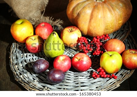 Autumn composition of fruits and pumpkins on table close-up