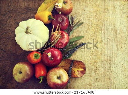Autumn concept background with seasonal fruits and vegetables, apples, pumpkin,peppers  and yellow fall leaves with copy space - stock photo