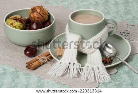 Autumn Concept. Cup Of Hot Coffee, Cocoa or Tea With Milk And Spices. Old Silver Spoon. Natural Linen Table Cloth. - stock photo