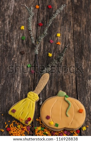 Autumn cookies for Halloween on old wood table - stock photo