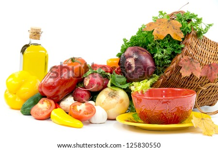 Autumn cornucopia with vegetables and olive oil - stock photo