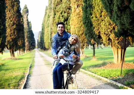 autumn. couple cycling in park