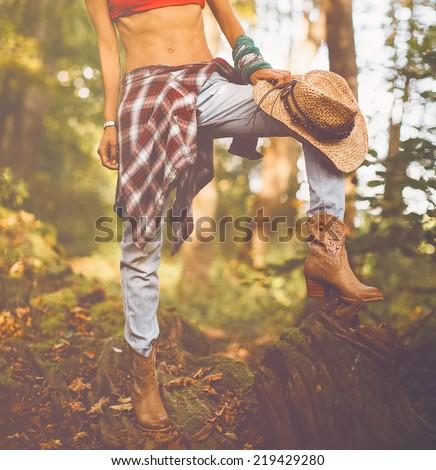 Autumn cowboy style. Fashion lady outdoors - stock photo