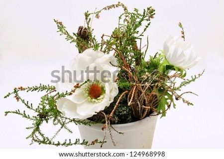 Autumn decoration of heather and two white flowers - stock photo