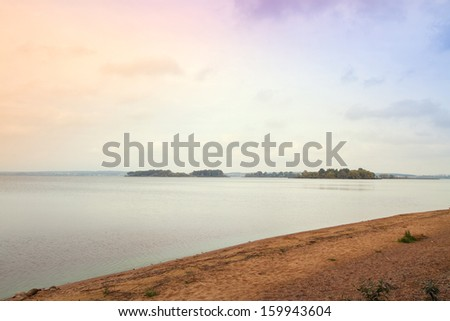 autumn evening by the lake - stock photo