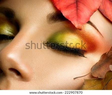 Autumn eye make-up. Closeup fashion makeup. Perfect face skin, colorful autumn eyeshadows, long eyelashes - stock photo