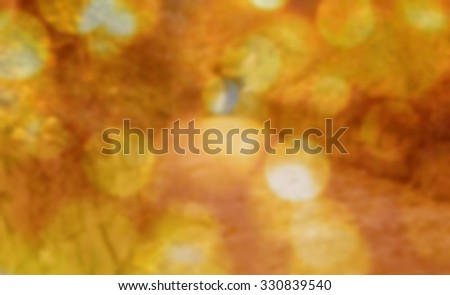 Autumn fallen leaves blurred effect yellowish, golden, Tinted filtered image Boke photo - stock photo