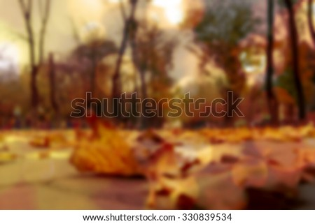 Autumn fallen leaves blurred effect yellowish, golden, Tinted filtered image photo - stock photo