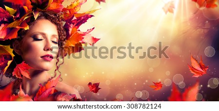 Autumn fantasy girl - Beauty fashion model with red leaves and sunlight  - stock photo