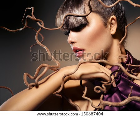 Autumn Fashion Model Girl with Perfect Makeup and Hairstyle. Haircut. Fringe. Beauty Woman  - stock photo