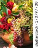 Autumn flowers and fruits in big composition - stock photo