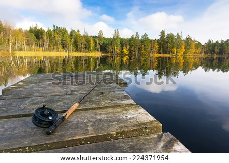 Autumn fly fishing in the lake - stock photo