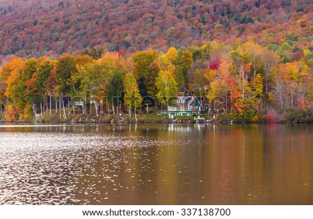 Autumn foliage and cabin in Elmore state park, Vermont. - stock photo