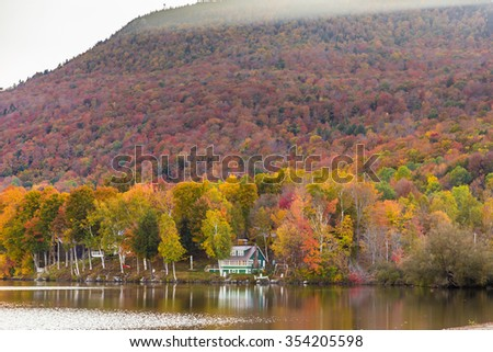 Autumn foliage in Elmore state park, Vermont. - stock photo