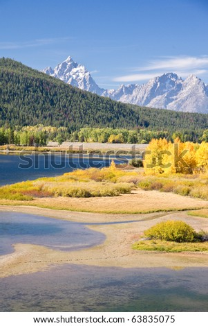 Autumn foliage in the Grand Teton mountain range - stock photo