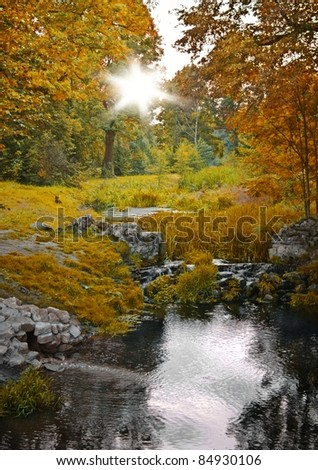 Autumn forest and stream, scenic landscape - stock photo