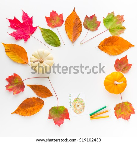 Autumn frame composition of colorful leaves and pumpkins. Top view.