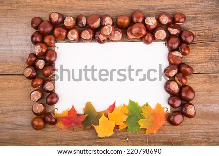autumn frame from maple leaves on the old wooden background. Copy space.