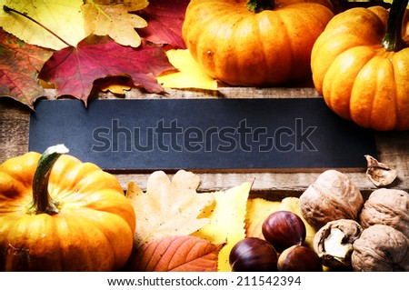 Autumn frame with pumpkins, walnuts and leaves - stock photo