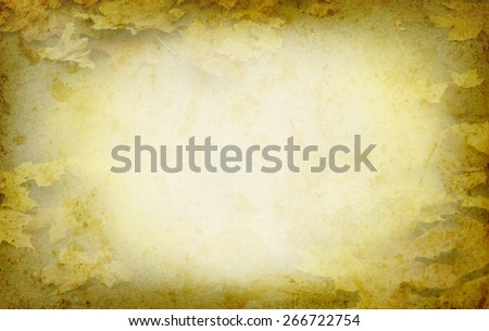 Autumn frame with yellow leafs at grange texture. Leaves texture with copy-space for text in frame on grunge paper. Old paper with maple leaves in autumn season and fall border in retro style. - stock photo