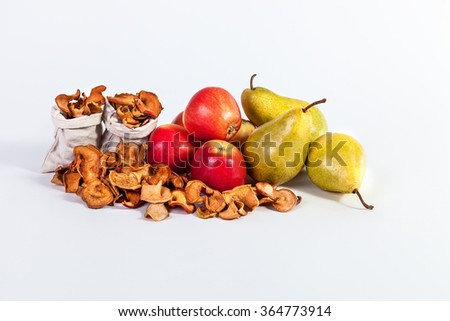 Autumn fruit still life Dried apples pears isolated on white background - stock photo
