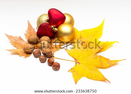 autumn fruits and yellow leaves, with various Christmas decorations on white background
